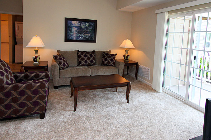 Living room of a 2 bedroom apartment at The Legends at Whitney Town Center